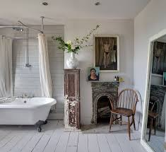 shabby chic bathroom design with decorative art work and white