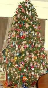 Antique Christmas Tree Ft Vintage Ornament Is Filled With Hundreds Of Ornaments And Surrounded By Toys
