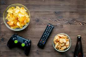console snack cuisine console concept with chips on wooden background top view