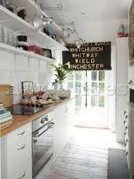 White Galley Kitchen With Vintage Kitchenware And Black Roller Blind In Winchester Home Hampshire