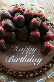 happy birthday chocolate cake photo happy birthday chocolate cake with strawberries toping