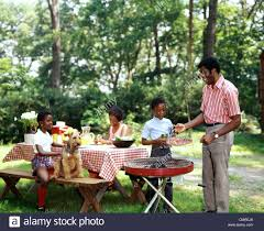 1970s AFRICAN AMERICAN FAMILY BACKYARD PICNIC BARBECUE Stock Photo ... Urban Pnic 8 Small Backyard Entertaing Tips Plan A In Your Martha Stewart Free Images Nature Wine Flower Summer Food Cottage Design For New Cstruction Terrascapes Summer Fun Have Eat Out Outside Mixed Greens Blog Best 25 Pnic Ideas On Pinterest Diy Table Chris Lexis Bohemian Wedding Shelby Host Your Own Backyard Decor Tips And Recipes