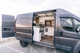 FOR SALE FULLY CONVERTED CAMPER VAN WITH 16k MILES