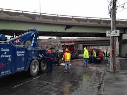 Syracuse City Block To Close Due To Damage From Roll-off Truck Crash ... New York Buff Media Truck Driver Pinned After Striking Overpass Hits Overpass Delays Train In Haven Wtnh Bridge Rolls Over On 8th Ave Offramp From I25 Fox31 Flatbed Truck Carrying Box Monroe Heraldnetcom Same Southern State Parkway Struck April Bus Cp Rail Coquitlam Scanbc Twitter Crews Scene With A Crane Hits Route 9 Berlin Nbc Connecticut 100th St Hit Again 4th Time This Year Stuck Under Closes Eries French Street News Nashville Inrstates Close After Semi Tctortrailer Fdr Drive Backs Up Traffic Wpix