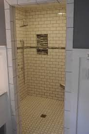white subway tile shower with accent amazing tile