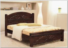 Carved Dark Brown Stained Wooden Bed Frame With Curved Birch