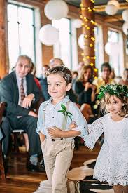 Ring Bearer And Flower Girl Walking Down The Aisle At Loom