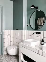 a parisian bathroom in white tile and blue paint baths