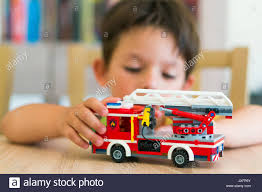 Young Boy Playing With Lego City Fire Truck On A Wooden Table On ... Amazoncom Lego City Fire Truck 60002 Toys Games Lego 7239 I Brick Station 60004 With Helicopter Engine Ladder 60107 Sets Legocom For Kids My 4x4 Building Set Ages 5 12 Shared By Fire Truck Other On Carousell Man Lot 4209 7206 7942 4208 60003 Young Boy Playing With A Wooden Table City Fire Ladder Truck Brubit