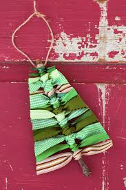 Use Sticks And Scraps Of Green Ribbon To Make This Rustic Scrap Christmas Tree Ornament