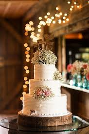 Romantic And Rustic Wedding Cake With Babys Breath Topper