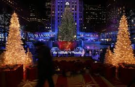 2012 rockefeller center tree lit ahead of period of