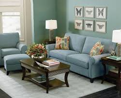 The Blue Green Wall And Light Couch Create A Relaxing Space With Cool