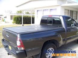 BakFlip F1 Tonneau Cover - Free Shipping & Price Match Guarantee Bestop Soft Top Supertop Truck Bed Cover Canvas Black Diamond Toyota Old Chevy Pickup With Custom Made House On Top Of The Truck Bed 4x4 Tonneau Towing Equipment Limited Red Pickup Vector Illustration Four Wheel Drive Car Isolated Herculoc Llc Is Announcing Its New Industrial For Tonnos Archives Toppers Lids And Accsories Plus Camper Tech Articles Rv Magazine 2011 Gmc Sierra Reviews Rating Motor Trend Ram Box Rack Retracted Removed Bars 2 Nuthouse Industries Nutzo Series Expedition Tents Compared Filecustomer Loading Atv On Heavyduty