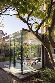 100 Glass Walled Houses Extension Breathes Life Into 1920s Brick House In The Hague