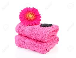pink bathroom accessories with towel stones and gerber flower