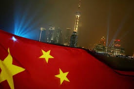 The Chinese Flag Flies With Pudong Skyline In Background