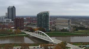 100 Miranova Condos 57K Stock Footage Aerial Video Reverse View Of Riverfront Condo Complex And Office Building By Bridge And River Downtown Columbus Ohio Aerial Stock