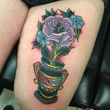 Unusual Purple Rose In A Gray Vase With Insertions Of Yellow And Green Colors On The