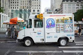 White Ice Cream Truck And Nuts4nuts Food Cart In Front Of Apple ...