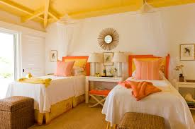 Tropical Yellow Floor Bedroom Idea In Boston With White Walls