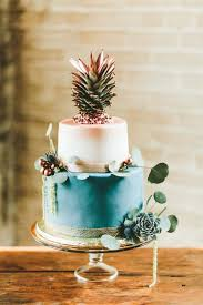 Teal And Copper Cake With A Pineapple Topper Is Perfect For Tropical Tablescape