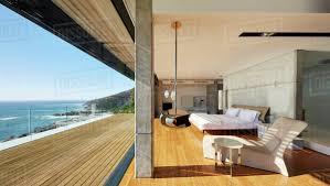 100 Modern Luxury Bedroom Luxury Bedroom Open To Patio With Sunny Ocean View Stock Photo