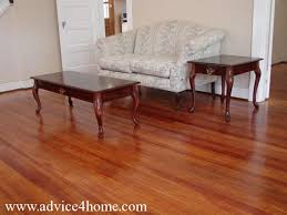Dark Red Hardwood Flooring And Sofa Design In Living Room