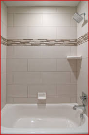 Bathroom Tub Tile 232608 Bathtub Tile Ideas Cozy Popular Tub ... Bathroom Good Looking Brown Tiled Bath Surround For Small Stunning Tub Tile Remodel Modern Pictures Bathtub Amazing Shower Ideas Design Designs Stunni The Part 1 How To Tile 60 Tub Surround Walls Preparation Where To And Subway Tile Design Remarkable Wall Floor Tiles Best Monumental Beveled Backsplash Navy Blue Argusmcom Paint Colors Frameless Doors Stall Replacing Of Jacuzzi Lowes To Her