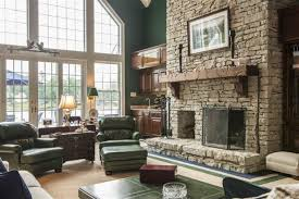 Rustic Living Room With Stone Fireplace Plus Frebch Door SconceCombined Green Sofa