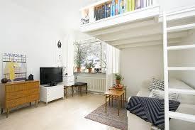 Small Swedish Studio Apartment Elegantly Combines Loft Bed And