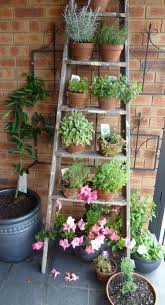 Creative IdeaInnovative Rustic Wood Ladder Garden Planter With Colorful Flowers On Stainless Pots Outdoor