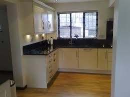 KitchenWhite Kitchen Cabinet In Small Space With Wooden Floor And Black Appliance White