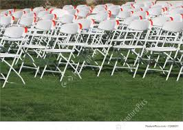 Architecture: Folding Chairs Set Up On A Green Lawn For An Event.