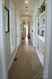 upstairs hallway has built in glass front display cabinets for