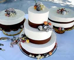 Brown And White Wedding Cakes Elegantly Adorned With Sugared Fruit