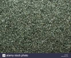 Black Or Dark Granite Abstract Natural Organic Texture With Rough Surface Used As Background In
