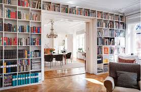 Wall Book Shelves With Bright Wooden Book Partitions And Full Wall