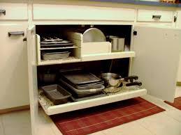 rustic white kitchen cabinet with pull out tray pots and pans