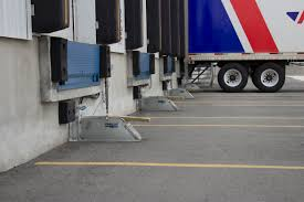 Texas Overhead Door - Loading Dock Equipment-Vehicle Restraints ... New Loading Dock Improves Safety And Convience Arnold Air Force Home Nova Technology Hss Dock Solutions Assists With Downtons Alcohol Distribution Dealing Hours Vlations Beyond Your Control In Elds Forklift Handling Container Box Loading To Truck In Stock Photo White Delivery At A Picture And For Airports Saco Airport Equipment Lorry Semi Tractor Trailer Backed Up To A Brooklyn Historical Warehouse Google Search Retro Freight Trucks Lowes Logo Or Unloading At Product The Spotlight Industrieweg 2 5731 Hr Ford Driving Off Super Slowmotion High