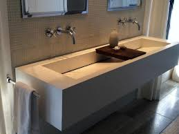 sophisticated white commercial trough sink with wooden soap dish
