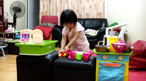 Joanna and her Plan Toys Kitchen Centre and Cooking Utensils