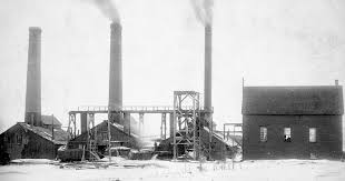 Photograph Of A Row Three Buildings Equipped With Large Smokestacks Number 1 Slope