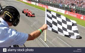 Finnish Formula One Driver Kimi Raikkonen Of Scuderia Ferrari Passes The Chequered Flag As He Wins