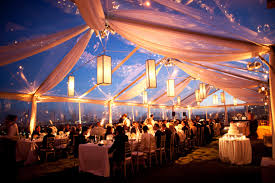 Tent Outdoor Wedding Reception Decorations With Thin Hanging Lanterns And Long Tables Small Wooden Chairs