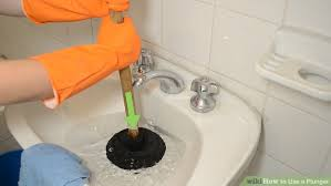 Unclogging A Bathtub With A Plunger by How To Use A Plunger With Pictures Wikihow