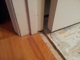 how to work out threshold transition between laminate tile