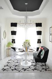 Black And White Striped Curtains Frame A Small Dining Room Space With Audubon Floral