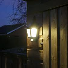 black outdoor solar security welcome wall light with pir best