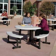 44 in round picnic table with 3 swing out benches almond